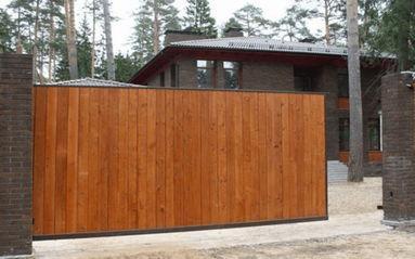 Изготовление откатных ворот из дерева